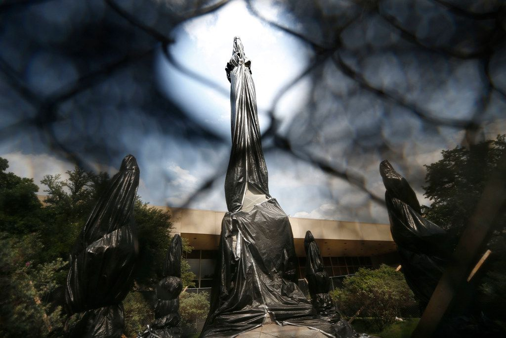 The statues and bases making up the Confederate War Memorial are wrapped in black plastic on May 20, 2019, in Dallas. The only things preventing the City of Dallas from removing the Confederate War Memorial from its location near City Hall and Dallas' convention center are a lawsuit and a request for a temporary restraining order filed in district court.