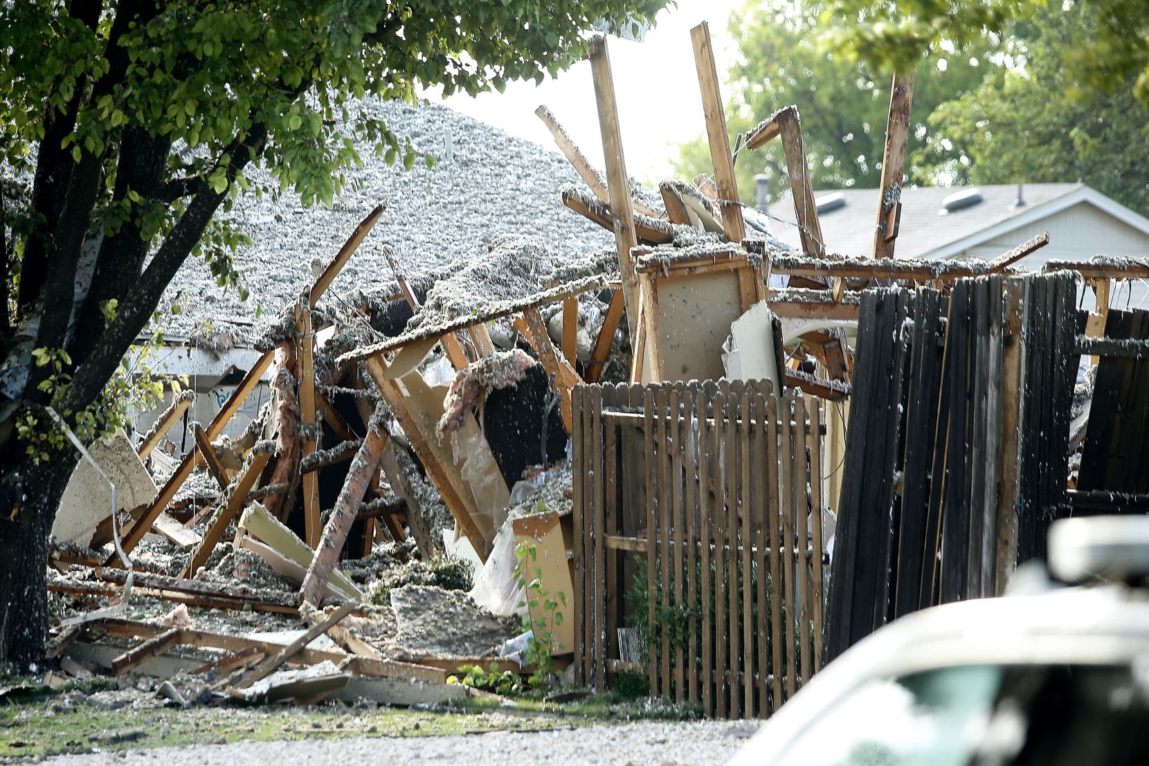 Debris was all that was left on the site of a home explosion Monday.