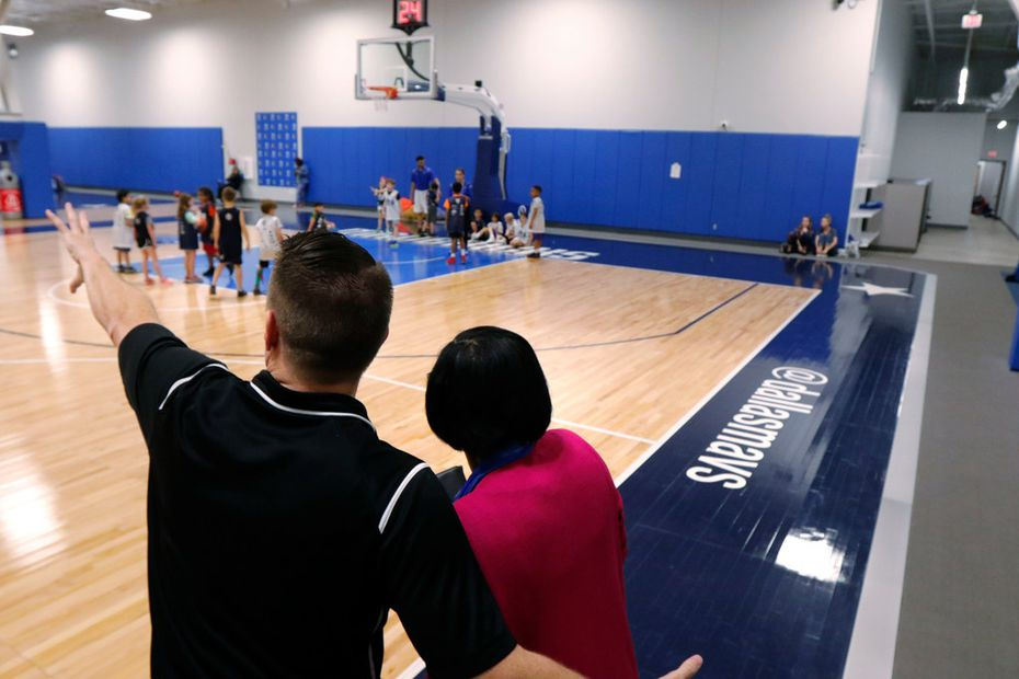 """Ben Hunt, left, Camps & Community Basketball Manager shows Dallas Mavericks interim CEO Cynt Marshall what takes place during one of the Mavs Spring Break Hoop Camp at the Mavericks gym, Friday, March 16, 2018. After 36 years, Cynt left AT&T after achieving """"rock star"""" status, according to co-workers. She left to launch a consulting firm focused in part on leadership and inclusion. (David Woo/The Dallas Morning News)"""