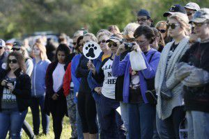 About 100 people gather to memorialize 91 dead animals found at Dowdy Ferry since last summer. (Brandon Wade/Special Contributor)