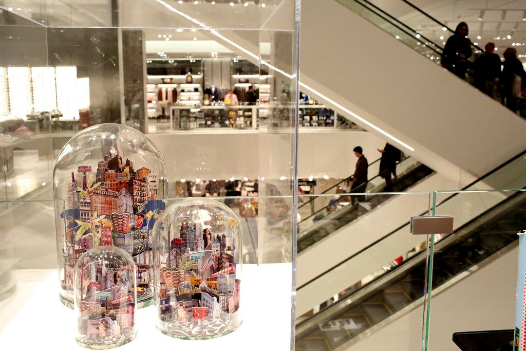 People gather inside Neiman Marcus, at the opening of Hudson Yards in Manhattan, New York on Friday, March 15.