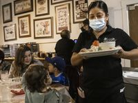 Dora Calderon serves customers at Los Vaqueros Restaurant in Fort Worth last month. Unemployment rates for Hispanics and Blacks in Texas remain much higher than for whites and have not been declining in the same fashion, according to a recent Dallas Fed article. (Lynda M. González/The Dallas Morning News)
