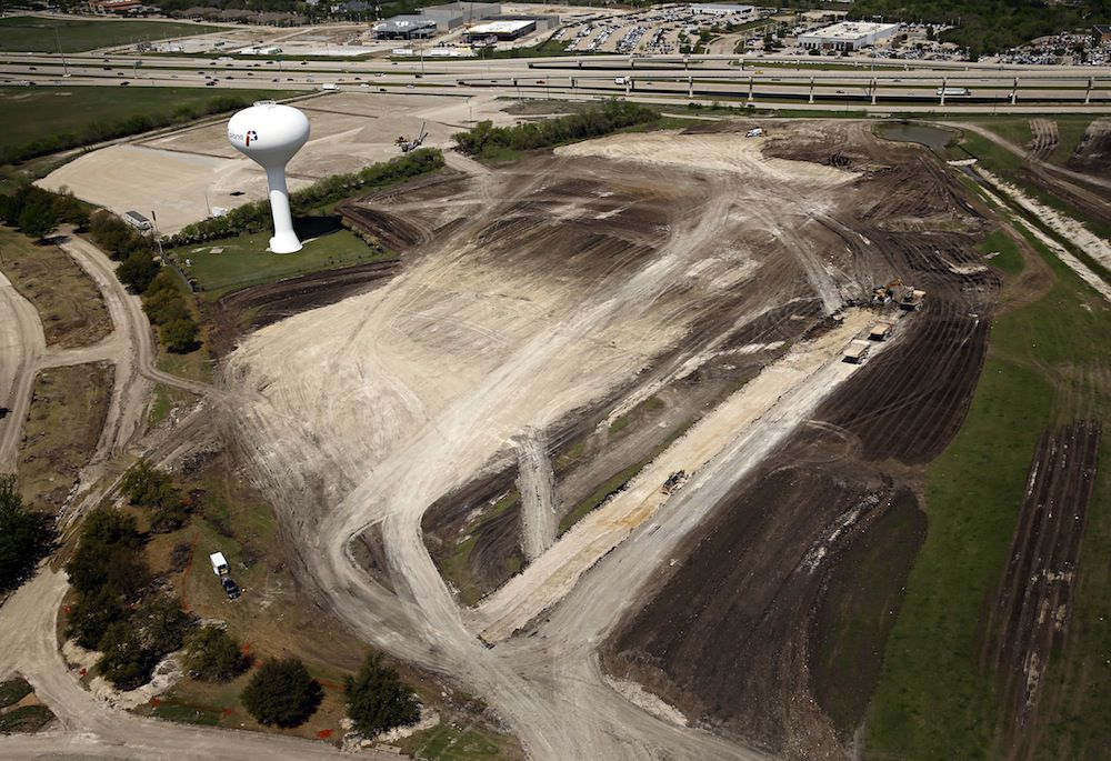 Work crews are already building new roads to access the site for Liberty Mutual's new Plano campus. (G.J. McCarthy/Staff Photographer)