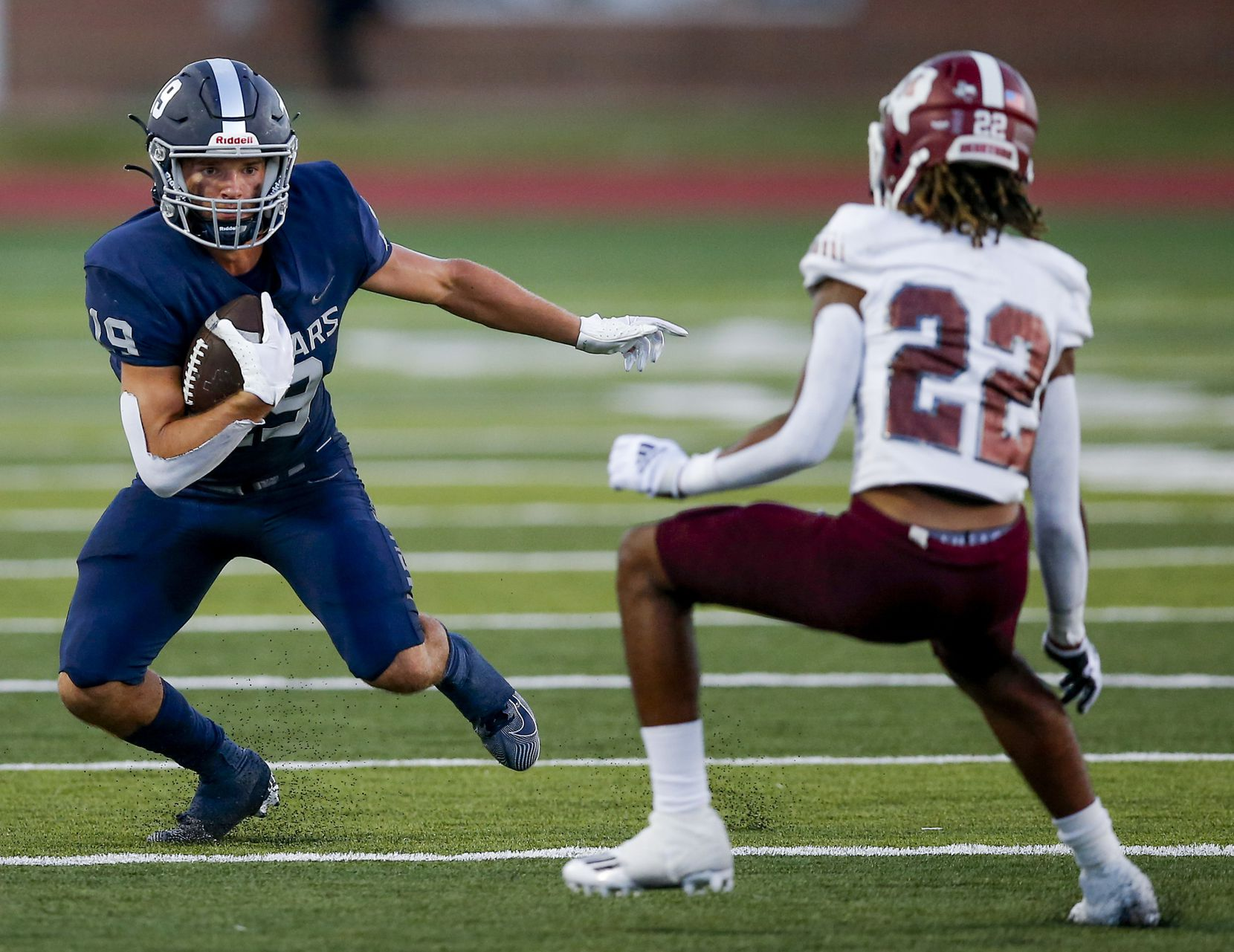 Flower Mound senior wide receiver Cade Edlein (19) looks for room against Mesquite junior defensive back Dalton Martin (22) during the first half of a high school football game at Flower Mound High School, Friday, August 27, 2021. (Brandon Wade/Special Contributor)