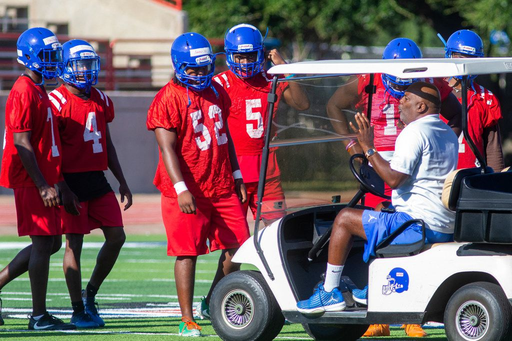 Duncanville coach Reginald Samples (right) coaches his players at Panther Stadium on the first day of practice Monday. (Lynda M. Gonzalez/The Dallas Morning News)