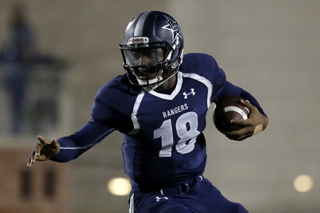 Frisco Lone Star Ranger's Jason Shelley looks to run with the ball during overtime as Lake Dallas faces Frisco Lone Star at Eagle Stadium in Allen on Friday, Dec. 11, 2015. The Frisco Lone Star Ranger's beat Lake Dallas Falcons 55-49. (Rachel Woolf/The Dallas Morning News)