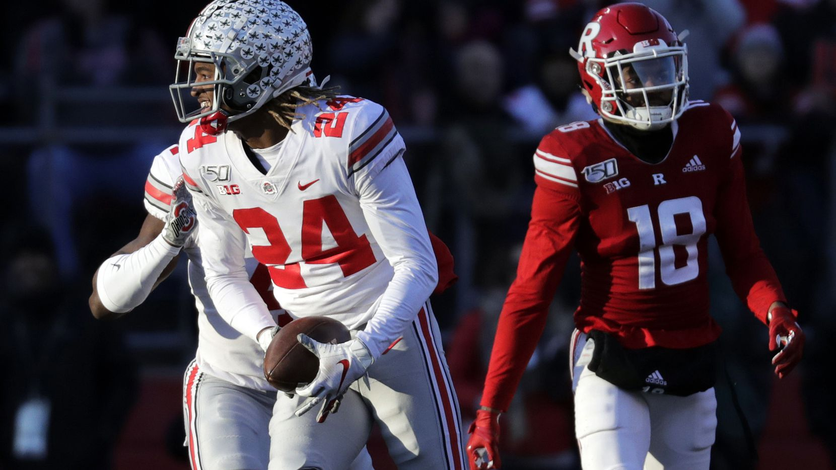 FILE - In this Nov. 16, 2019, file photo, Ohio State cornerback Shaun Wade (24) reacts after making an interception during the first half of a game against Rutgers in Piscataway, N.J. (AP Photo/Adam Hunger, File)