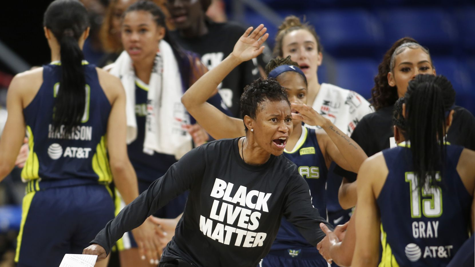 Dallas Wings head coach Vickie Johnson enthusiastically greets her players as they head to the team bench for a called time-out during the first quarter of play against the Minnesota Lynx. The two teams played their WNBA game at College Park Center on the campus of the University of Arlington on June 17, 2021.