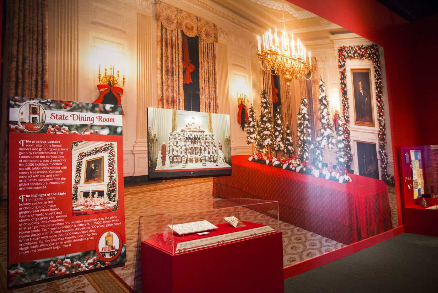Photos of the State Dining Room are displayed at a Christmas exhibit at The George W. Bush Presidential Center and Library on Thursday, November 15, 2018 on the SMU campus in Dallas. This year's theme is Deck the Halls and Welcome All: Christmas at the White House 2006. (Ashley Landis/The Dallas Morning News)