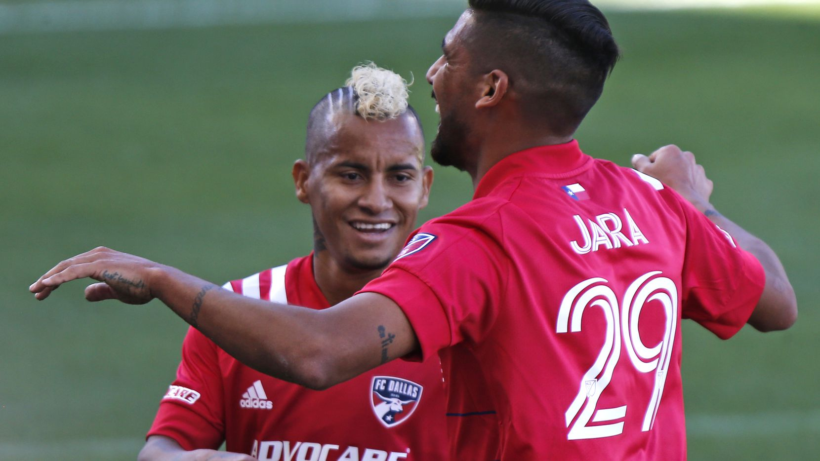 FC Dallas forward Franco Jara (29) is embraced by FC Dallas midfielder Michael Barrios (21) after Jara scored a goal during the first half as FC Dallas hosted the Houston Dynamo at Toyota Stadium in Frisco on Saturday afternoon, October 31, 2020. (Stewart F. House/Special Contributor)