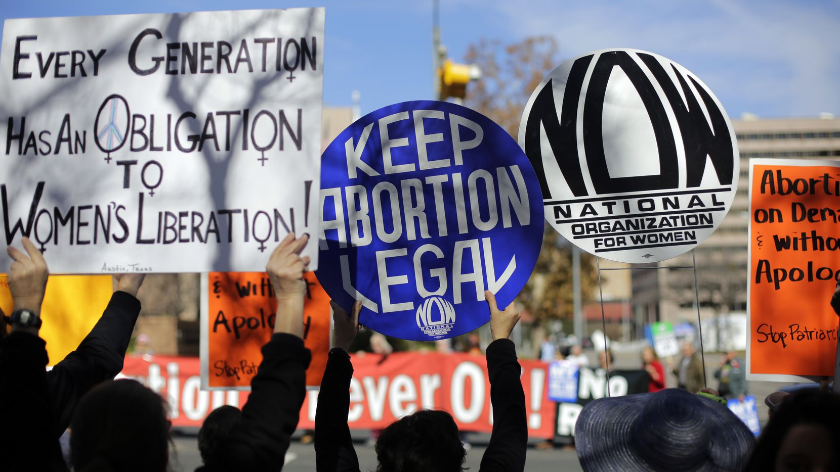 A pro-abortion supporters, foreground,  try to disrupt anti-abortion supporters as they march to the Texas Capitol during a Texas Rally for Life, Saturday, Jan. 24, 2015, in Austin, Texas. (AP Photo/Eric Gay)