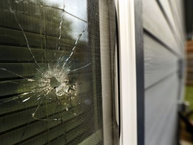 A bullet hole is seen in the rear window of Atatiana Jefferson's home in Fort Worth on Oct. 15, 2019.