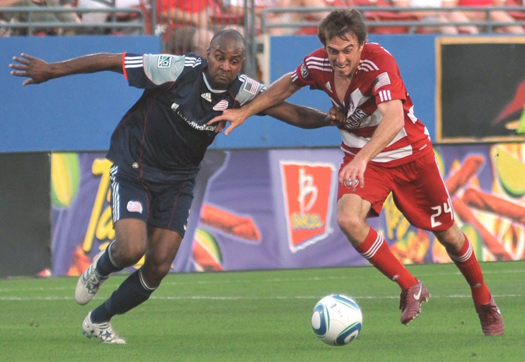 Revolution's Didier Domi (3) pulls on FC Dallas' Eric Alexander (24) jersey as both race for a ball during a Major League Soccer match at Pizza Hut Park in Frisco on June 4, 2011. FC Dallas won the match 1-0 over New England. (Mark M. Hancock / Special Contributor) 06052011xSPORTS