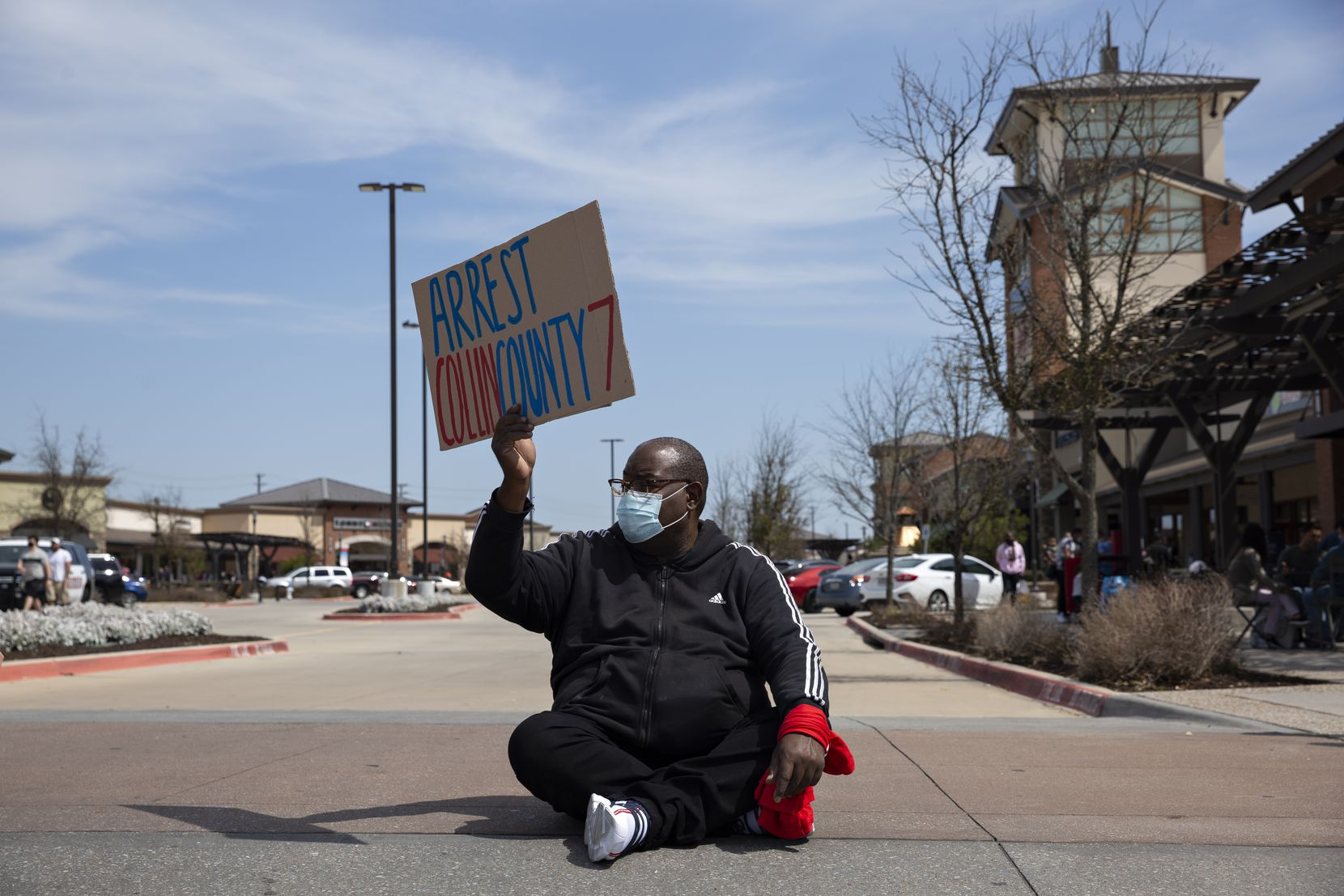 Marvin Scott Jr. sits in the road with other demonstrators to block traffic in the Allen Outlets on Sunday, March 21, 2021 demanding justice for his son Marvin Scott III, who died a week prior while in custody at the Collin County Jail on March 14, 2021. Marvin Scott III was arrested at the Allen Outlets for possession of less than two ounces of marijuana. Demonstrators called for the arrest of the ÒCollin County SevenÓ, the seven Collin County Jail employees who were placed on leave after MarvinÕs death. (Shelby Tauber/Special Contributor)
