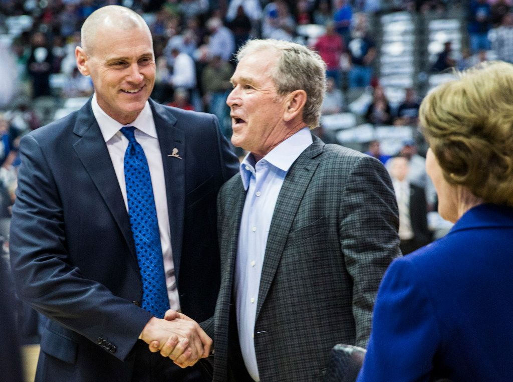 Dallas Mavericks head coach Rick Carlisle greets former President George W. Bush and former First Lady Laura Bush while wounded service members from Brooke Army Medical Center watch the Dallas Mavericks take on the Denver Nuggets on Monday, December 4, 2017 at the American Airlines Center in Dallas.