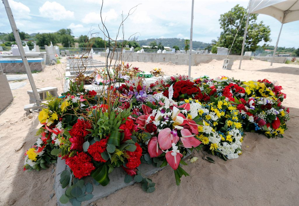 Three weeks after Botham Shem Jean was slain by Dallas Officer Amber Guyger in his Dallas apartment, he was buried in Castries, St. Lucia on Monday. A tent and flowers still covered his grave on Tuesday.