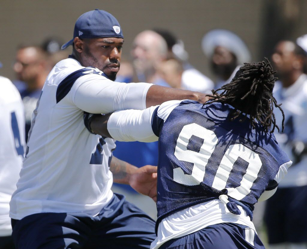 Dallas Cowboys defensive end Demarcus Lawrence (90) attempts to pass by Dallas Cowboys tackle Tyron Smith (77) on play during the morning walk through at training camp in Oxnard, California on Tuesday, July 25, 2017. (Vernon Bryant/The Dallas Morning News)