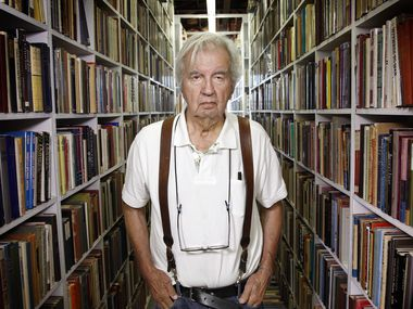 Pulitzer Prize-winning author Larry McMurtry posed for The Dallas Morning News in August 2012, while liquidating much of his book inventory in Archer City, Texas.