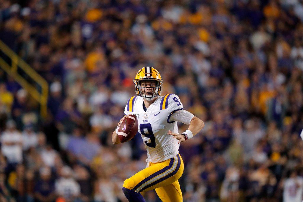 LSU quarterback Joe Burrow (9) scrambles in the first half of an NCAA college football game against Texas A&M in Baton Rouge, La., Saturday, Nov. 30, 2019. (AP Photo/Gerald Herbert)