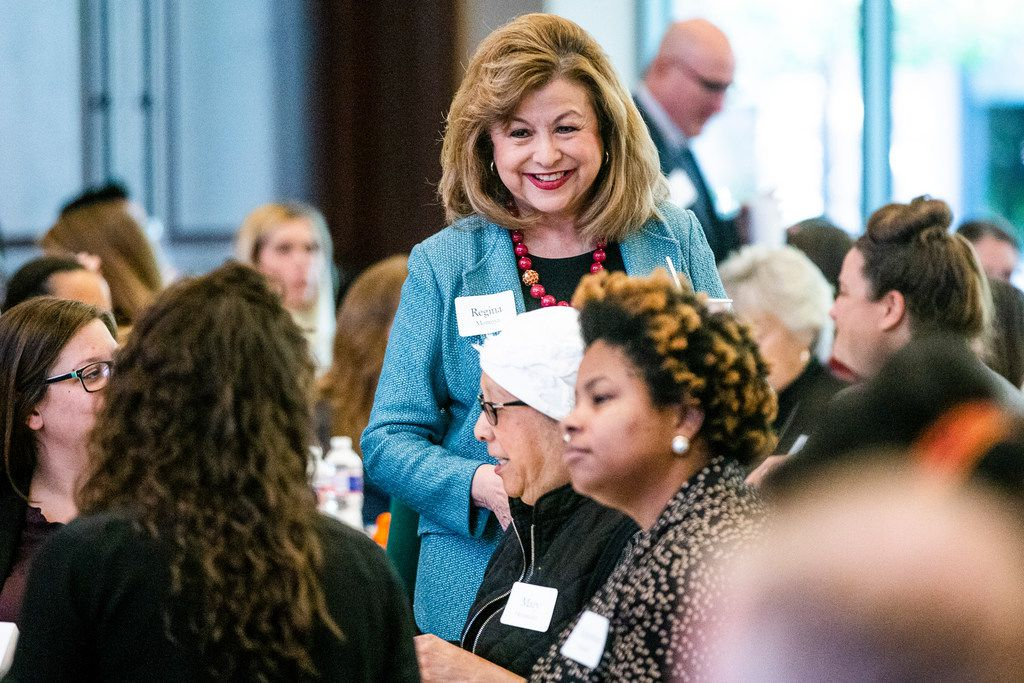 Mayoral candidate Regina Montoya talked with audience members before the Center for Public Policy Priorities' workshop on Tuesday in Dallas.