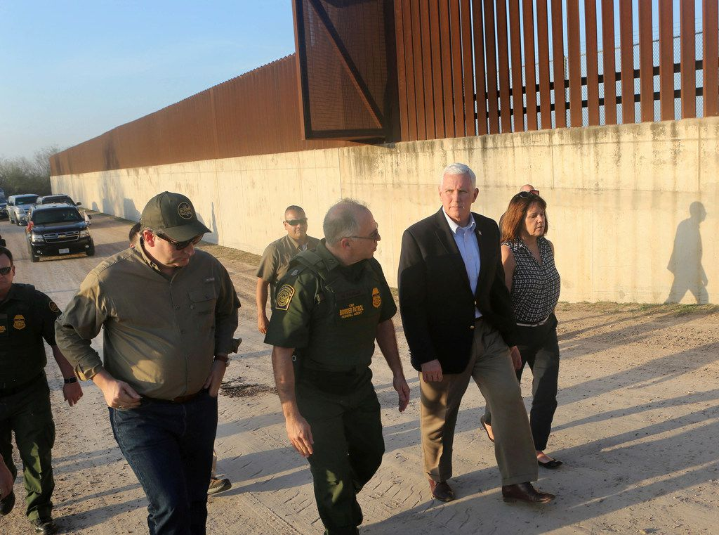 Vice President Mike Pence listened to Manuel Padilla, U.S. Border Patrol Rio Grande Valley sector chief, while touring the border wall with Sen. Ted Cruz and wife Karen Pence on Friday, Feb. 16, 2018, in Hidalgo, Texas. Pence spent the afternoon touring the U.S.-Mexico border and talking with federal law enforcement officers on their efforts to secure the border.