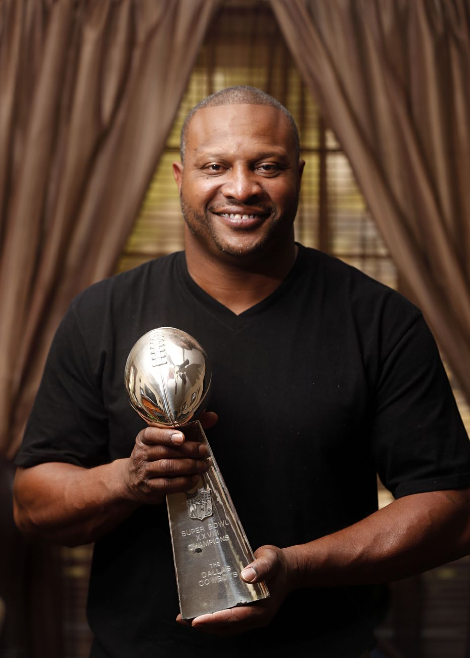 Former Dallas Cowboys running back Lincoln Coleman, pictured at his childhood home in Dallas on November 26, 2013., with the Super Bowl Trophy from 1993.