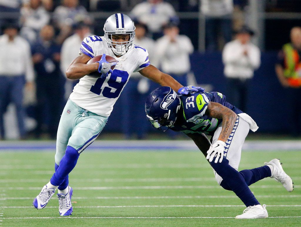 Cowboys wide receiver Amari Cooper (19) tries to avoid a tackle by Seattle Seahawks free safety Tedric Thompson (33) in the second quarter of an NFC wild-card game at AT&T Stadium in Arlington on Saturday, Jan. 5, 2019. (Tom Fox/The Dallas Morning News)