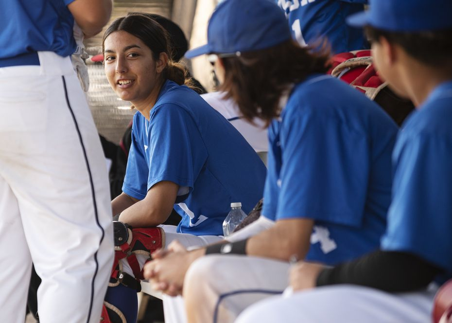 Adamson High School senior Tatyana Beltran (2), smiles while joking with teammates on the bench during a baseball game versus Spruce High School, on Tuesday, April 20, 2021 at Spruce High School in Dallas. Beltran, 18, has been playing baseball since the age of 9; some of her current teammates grew-up with her playing baseball. Beltran pitches, plays in-field at third base, catches, and isn't afraid to get hit by a pitch for she was hit twice on Tuesday without attempting to dodge the ball.