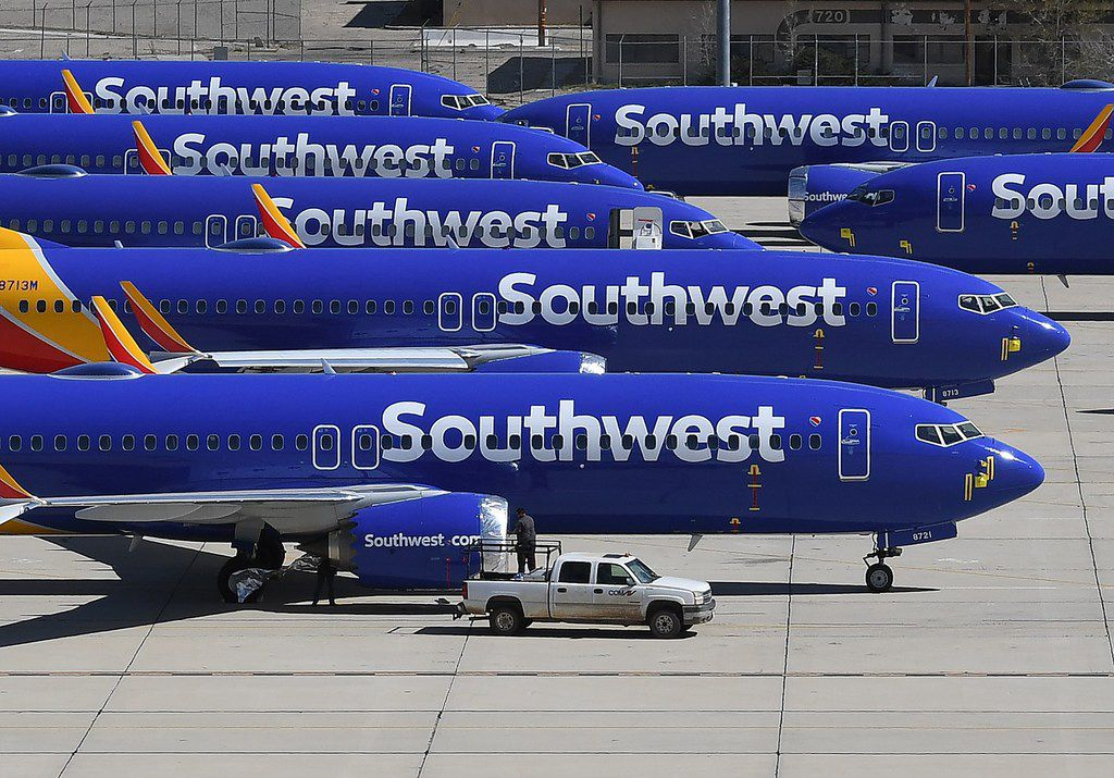 Southwest Airlines Boeing 737 MAX aircraft are parked on the tarmac after being grounded, at the Southern California Logistics Airport in Victorville, Calif., on March 28, 2019.
