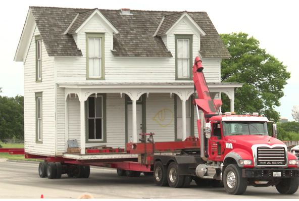 Crews carefully move the historic Miss Belle's Place down Lookout Drive in Richardson.