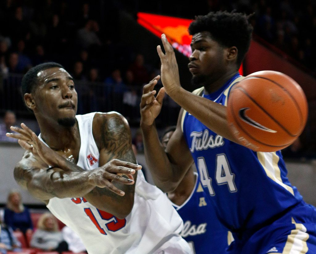 SMU forward Isiaha Mike (15) passes around the defense of Tulsa forward Simon Falokun (44) during first half action. The Mustangs won the game, 77-57. The two teams played their NCAA mens basketball game at SMU's Moody Coliseum in Dallas on January 12, 2019. (Steve Hamm/ Special Contributor)