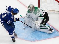 Goaltender Anton Khudobin (35) of the Dallas Stars makes a save against Brayden Point (21) of the Tampa Bay Lightning during Game Five of the Stanley Cup Final at Rogers Place in Edmonton, Alberta, Canada on Saturday, September 26, 2020.
