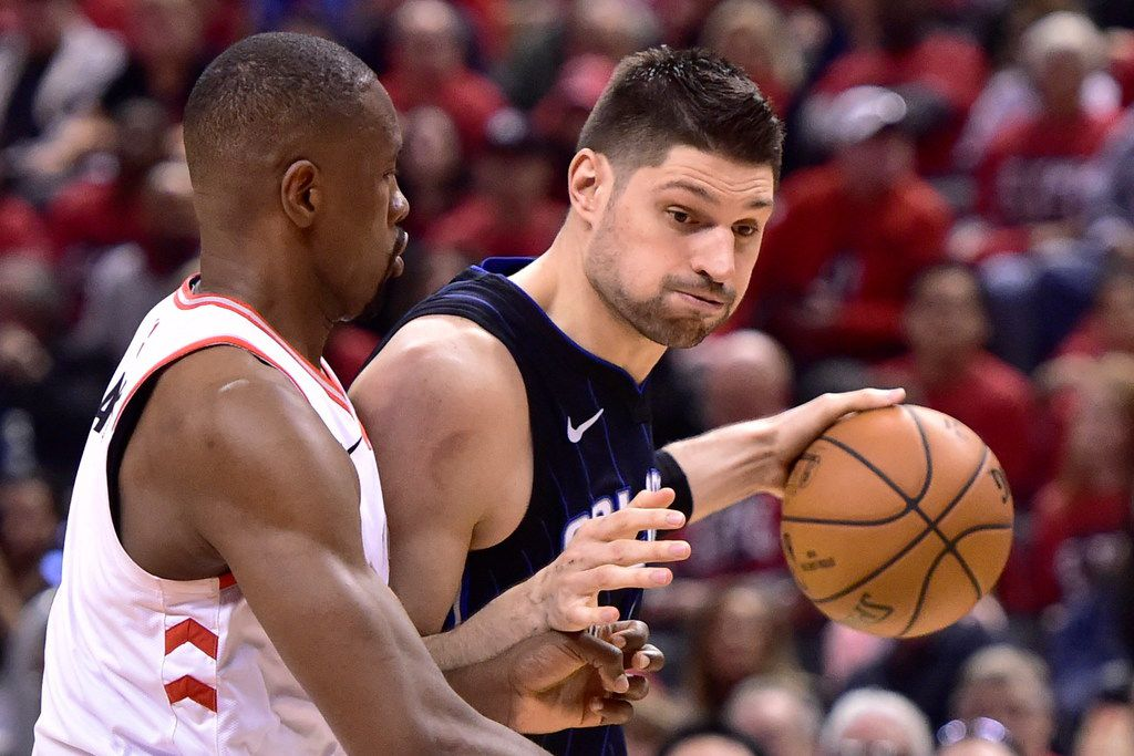 Magic center Nikola Vucevic (9) controls the ball with Raptors center Serge Ibaka (9) defending him during the second half of a first-round playoff game in Toronto on Saturday, April 13, 2019. (Frank Gunn/The Canadian Press via AP)