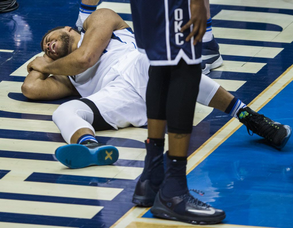 Dallas Mavericks guard Justin Anderson (1) falls to the ground after Oklahoma City Thunder forward Kevin Durant (35) fouls him during the fourth quarter of game 4 of their series in the first round of NBA playoffs on Saturday, April 23, 2016 at the American Airlines Center in Dallas. Durant was ejected from the game after this play. (Ashley Landis/The Dallas Morning News)