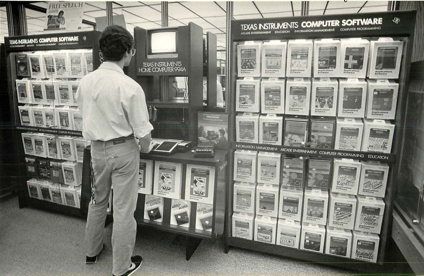October 29, 1983: A customer looks through some Texas Instruments software items