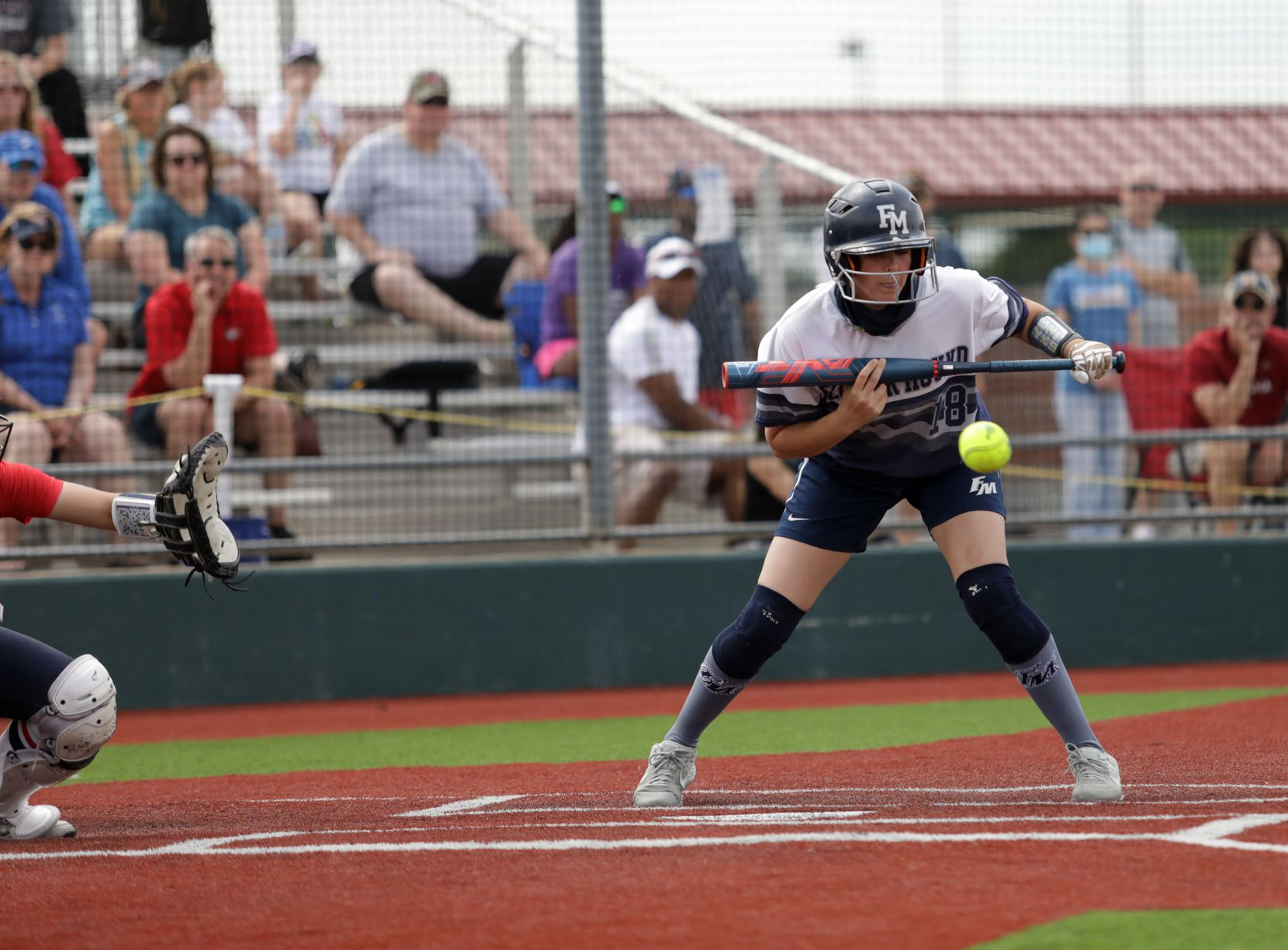 Flower Mound High School player #18, Jordyn Holland, holds back from a bunt during a softball playoff game against Allen High School at Allen High School in Allen, TX, on May 15, 2021. (Jason Janik/Special Contributor)