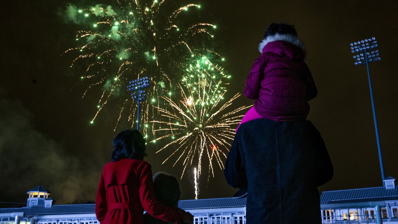 A family watches fireworks at the Day 1 festival in 2019.