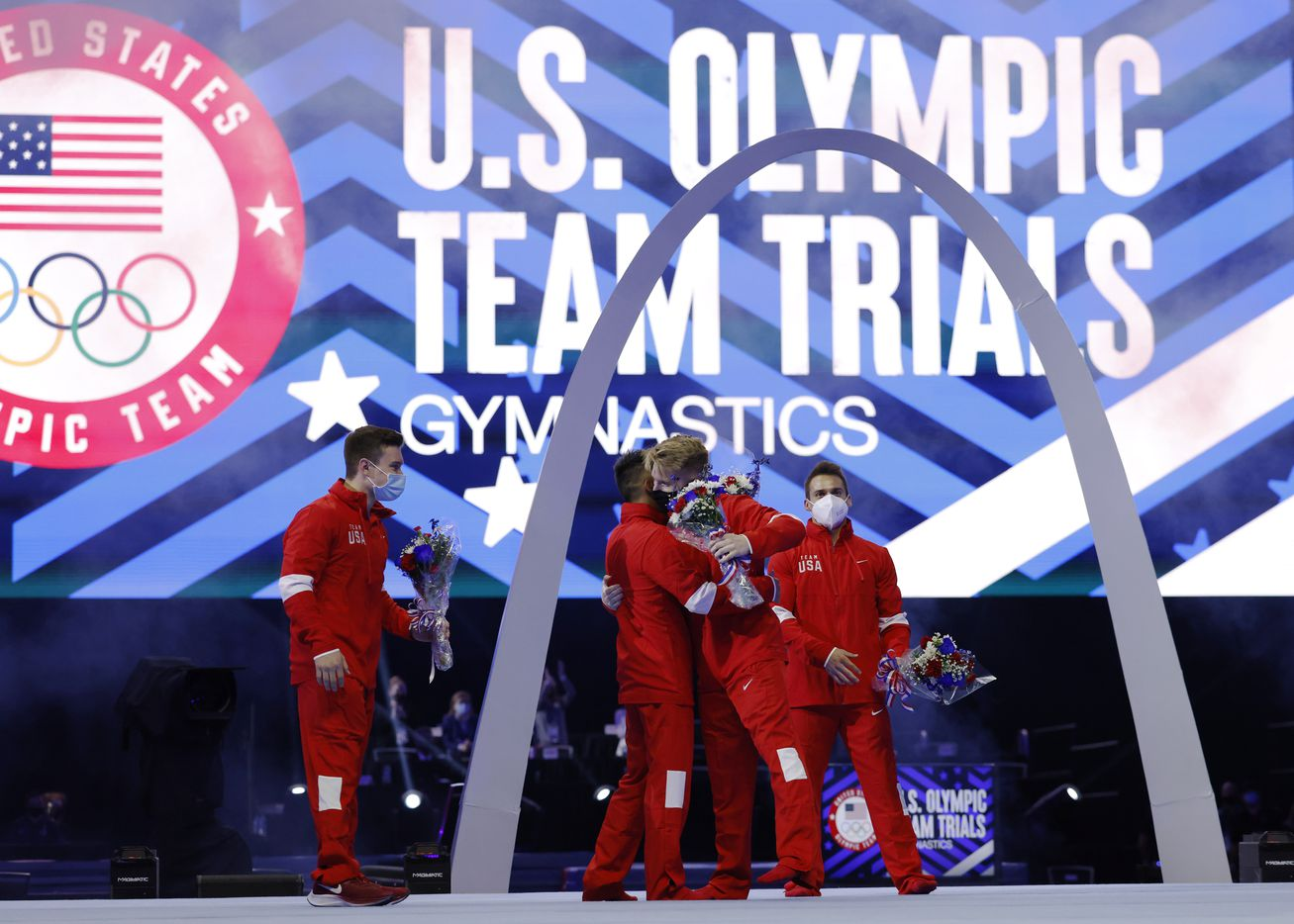 Yul Moldauer (center left) hugs Shane Wiskus (center right) as Brody Malone (far left) and Sam Mikulak (far right) are all introduced as the U.S. Olympic men's gymnastics team during day 2 of the men's 2021 U.S. Olympic Trials at America's Center on Saturday, June 26, 2021 in St Louis, Missouri.(Vernon Bryant/The Dallas Morning News)