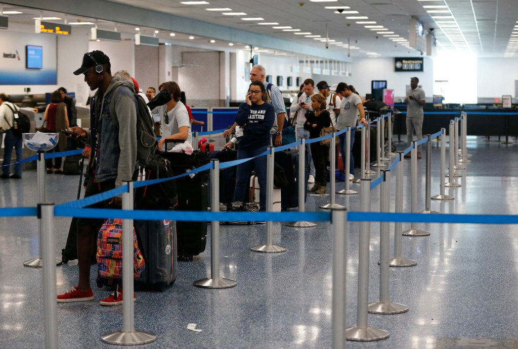 Travelers lined up Friday at the American Airlines counter at Miami International Airport. Hurricane Irma scraped Cuba's northern coast on a course toward Florida, leaving in its wake a ravaged string of Caribbean resort islands strewn with splintered lumber, corrugated metal and broken concrete.