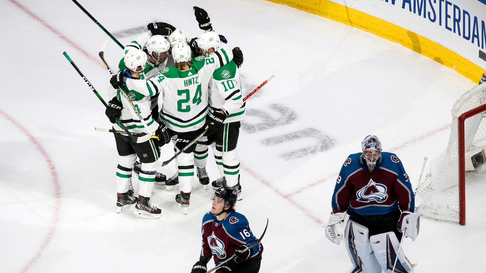 Dallas Stars, top, celebrate a goal against Colorado Avalanche goalie Pavel Francouz (39) as Avalanche's Nikita Zadorov (16) reacts during second-period NHL Western Conference Stanley Cup playoff hockey game action in Edmonton, Alberta, Monday, Aug. 24, 2020.