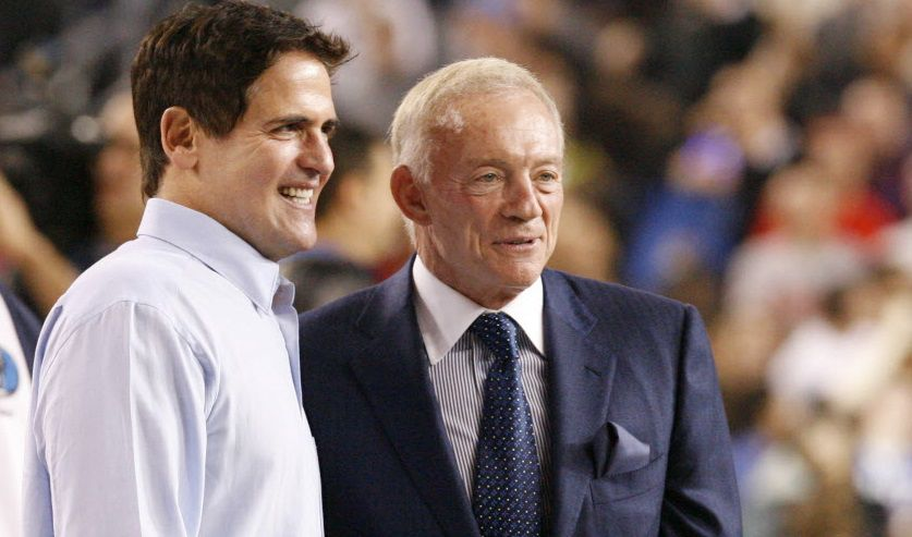 Dallas Mavericks owner Mark Cuban, left, and Dallas Cowboys owner Jerry Jones, right, announced the attendance of over 108,000 to watch the All-Star game, during the NBA All-Star Game at Cowboys Stadium in Arlington, Texas, on Feb. 14, 2010.