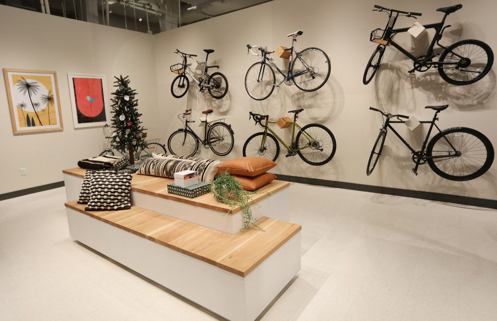 A sitting area and bicycles in Neighborhood Goods, a new concept store at Legacy West, in Plano on Nov. 16, 2018.