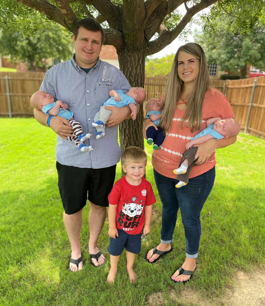 Katie and Chris Sturm with their quadruplets and 3-year-old son, Ryan.