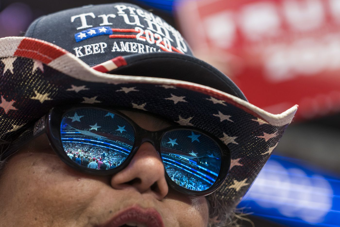 A supporter cheers President Donald Trump as he speaks during a campaign rally at the American Airlines Center on Thursday, Oct. 17, 2019, in Dallas.