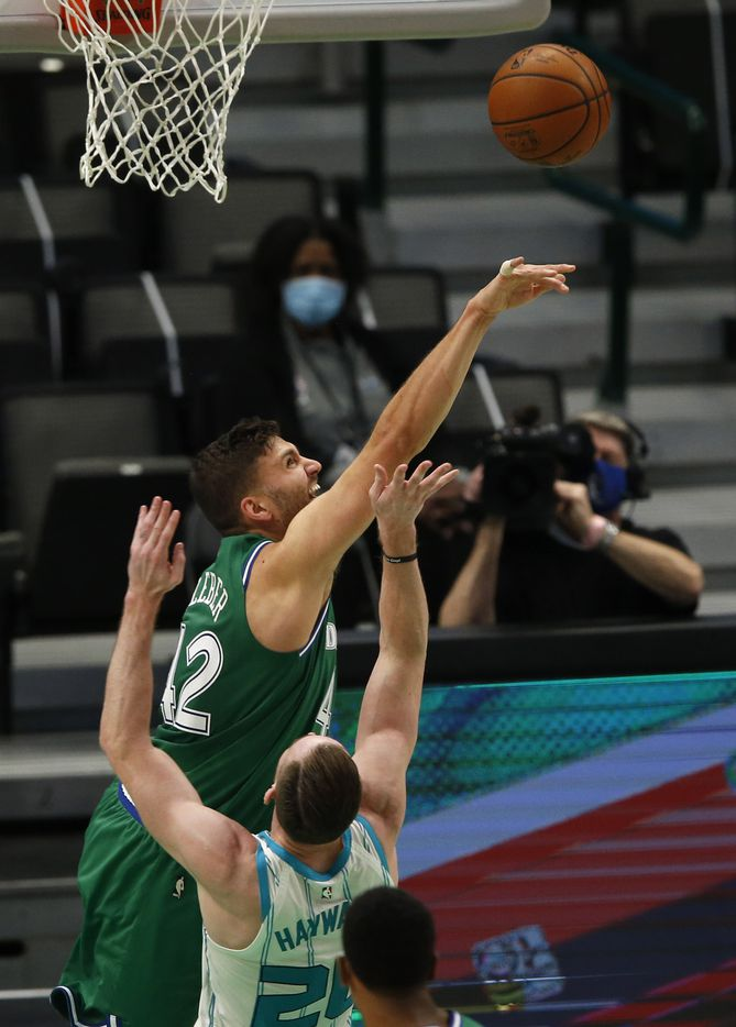 Dallas Mavericks forward Maxi Kleber (42) blocks a shot attempt from Charlotte Hornets forward Gordon Hayward (20) during the second quarter of play in the home opener at American Airlines Center on Wednesday, December 30, 2020 in Dallas. (Vernon Bryant/The Dallas Morning News)
