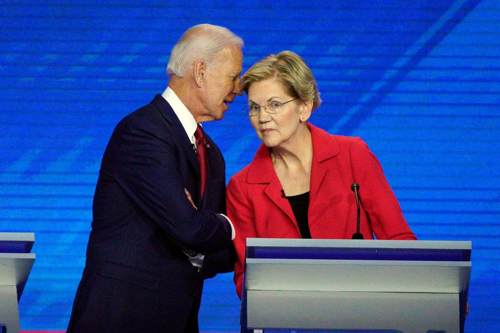 Democratic presidential candidates former Vice President Joe Biden, left, and Sen. Elizabeth Warren, D-Mass., talked during a break Thursday, Sept. 12, 2019, during a Democratic presidential primary debate hosted by ABC at Texas Southern University in Houston.