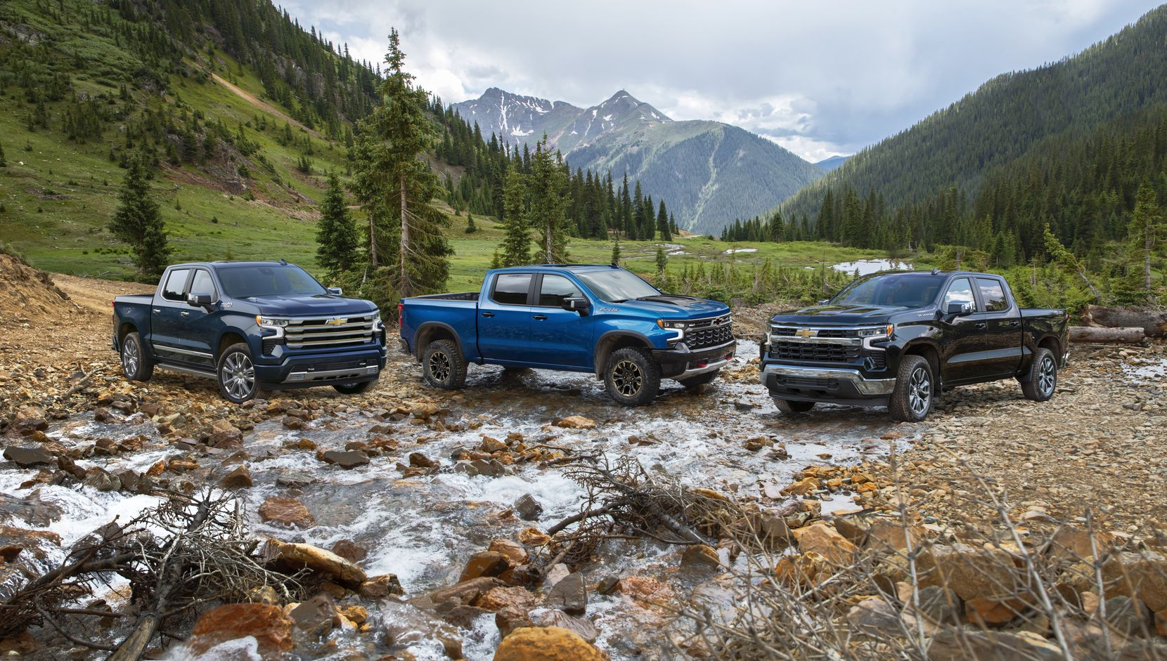 The 2022 Chevrolet Silverado High Country (left), ZR2 and LT models.