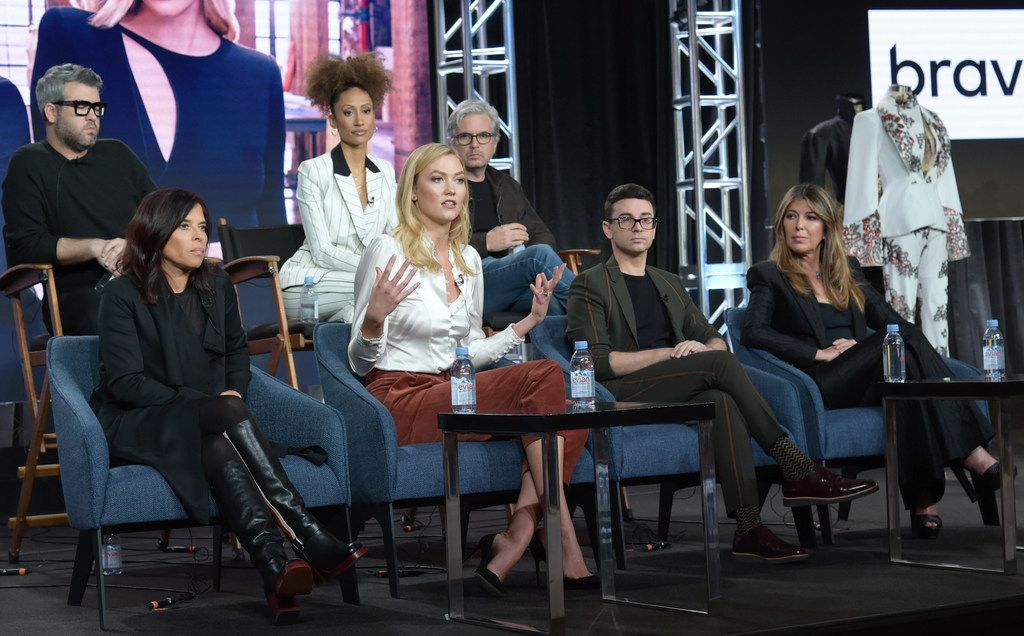 """Executive producer Jane Lipsitz, from front row left, Karlie Kloss, Christian Siriano, Nina Garcia, and from back row left, Texas-native Brandown Maxwell, Elaine Welteroth and executive producer Dan Cutforth participate in Bravo's """"Project Runway"""" panel during the NBCUniversal TCA Winter Press Tour."""