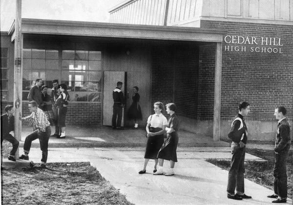 Students stand outside of the original Cedar Hill High School in 1957, the year it opened.