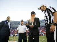 Dallas Mayor Eric Johnson (left) and ZZ Top's Billy Gibbons (second to left) prepare for the coin toss before the start of a game between Southern Methodist Mustangs and the Tulane Green Wave on Thursday, Oct. 21, 2021, at Gerald J. Ford Stadium on the campus of SMU in Dallas. (Juan Figueroa/The Dallas Morning News)